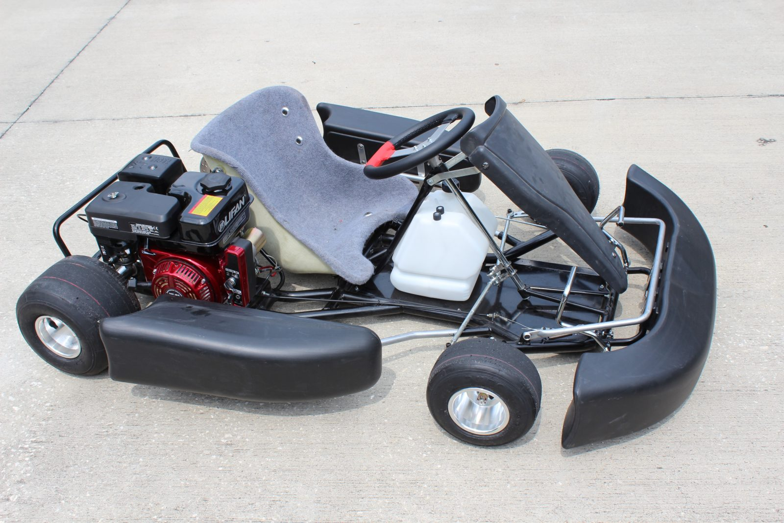 Tag racing kart for sale racing karts through bintelli for Motor go kart for sale